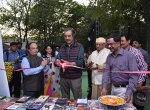 Shri Kiran Shantaram inaugrates the Films Division marketing stall at the Chanda International Documentary Film Festival, Chandrapur.