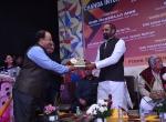 Shri Manish Desai Felicitates Shri Hansrajji Ahir, Hon. Minister of State of Home Affairs, GoI.