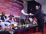 Shri K.R.Dixit felicitates Shri Sudhir Mungantiwar, Hon. Minister of Finance, Planning & Forest Department, Govt. of Maharashtra.