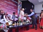 Shri Manish Desai Felicitates Shri Kiran Shantaram.