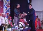 Shri K.R.Dixit felicitates Shri Mike Pandey