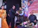 Shri K.R.Dixit felicitates Shri Manish Desai